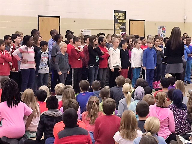 Alcott students sing during the Respect Assembly