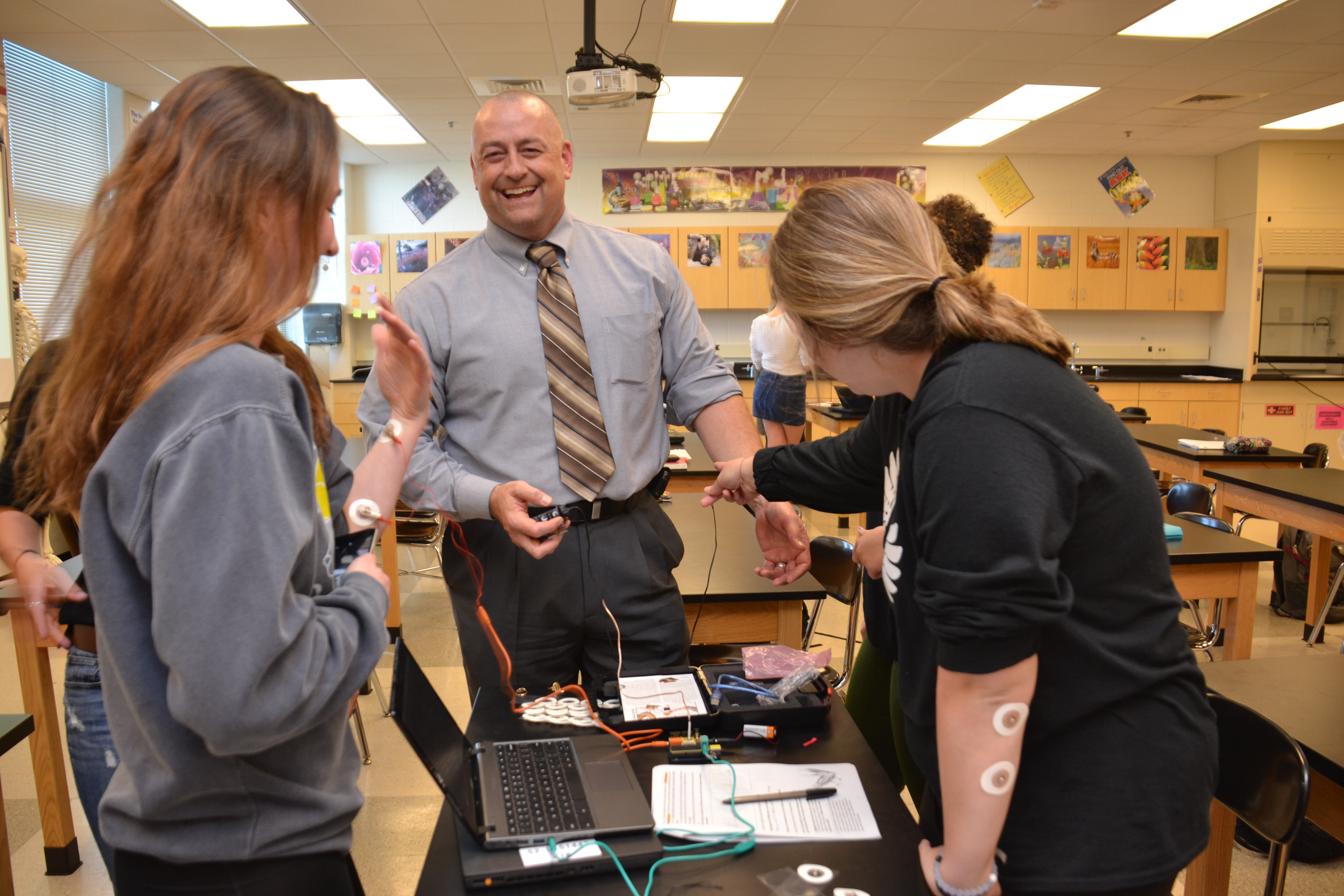 Principal Todd Spinner shares a laugh with students