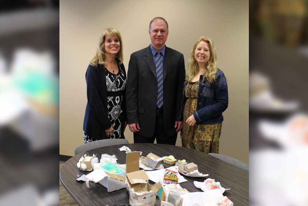 Picture of Debbie Pellington, Doctor Lisa Huelskamp and Deputy Superintendent Mark Hershiser