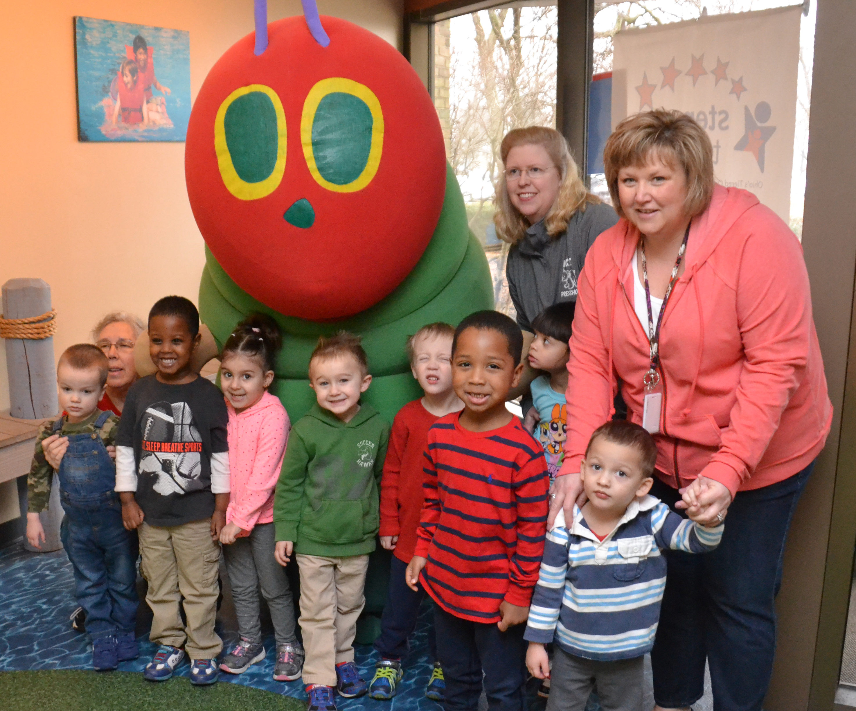 Students meeting the Very Hungry Caterpillar