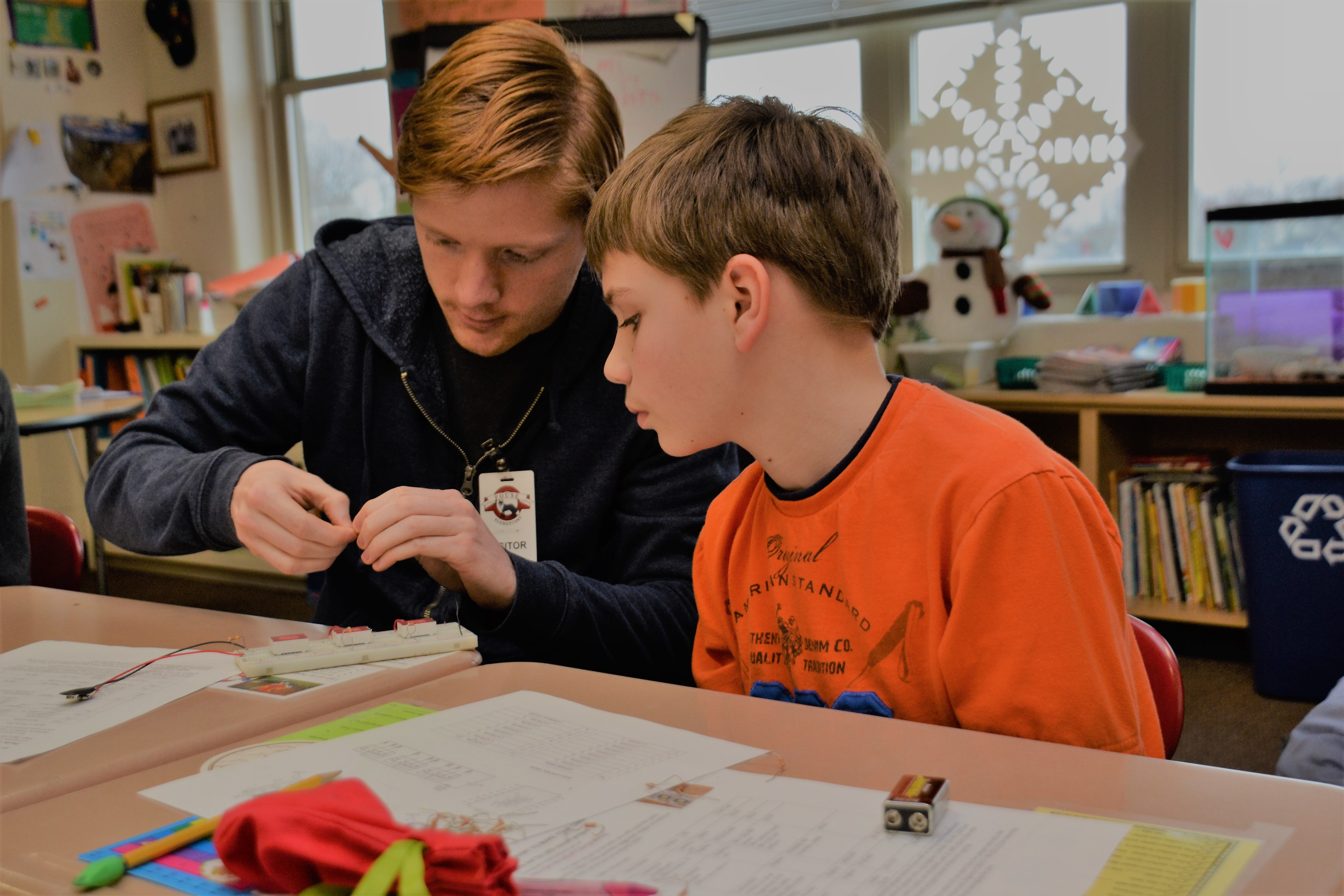 OSU engineering student Aidan Plunkitt with a Fouse fourth grader.