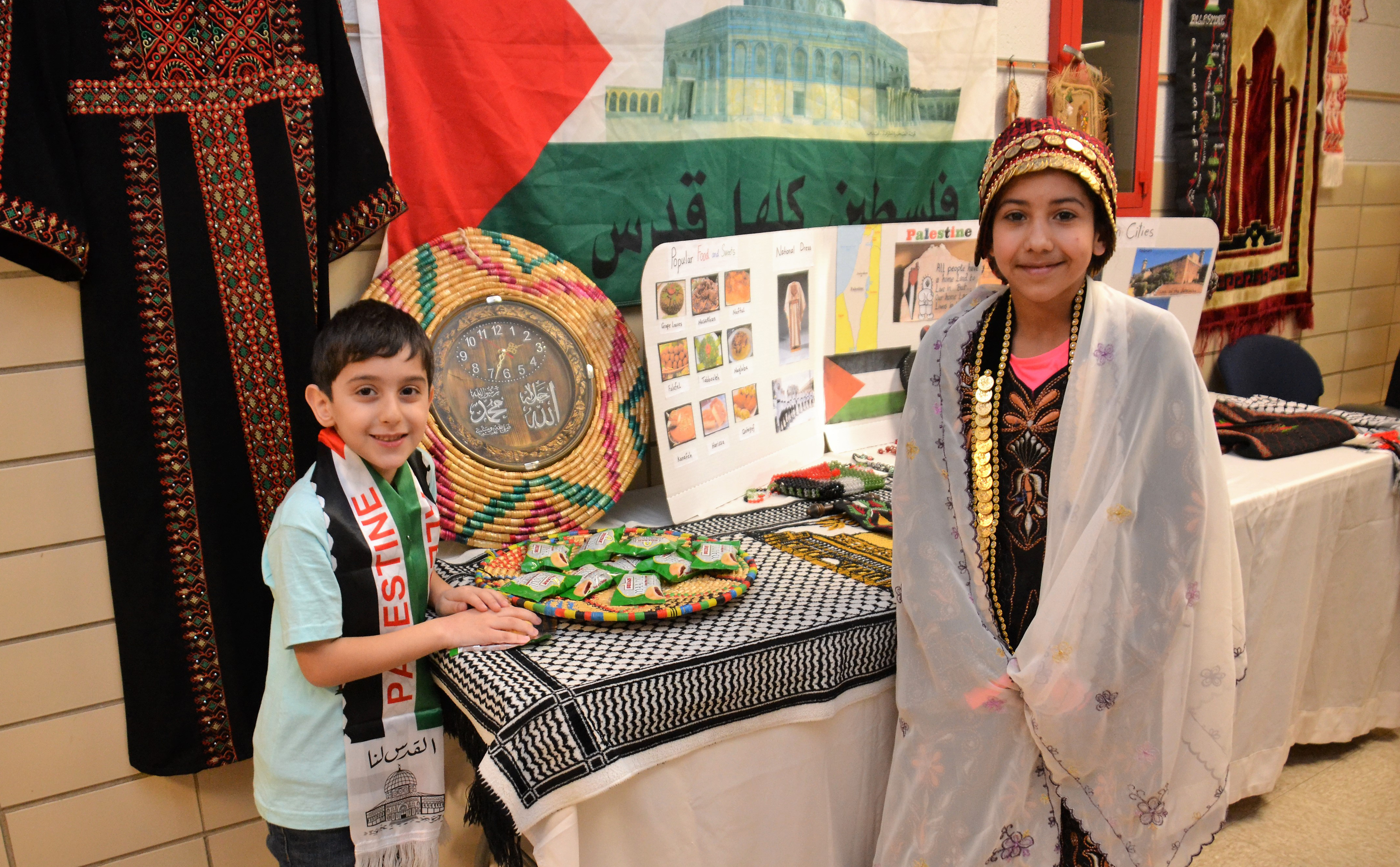 Two students representing their Palestine culture
