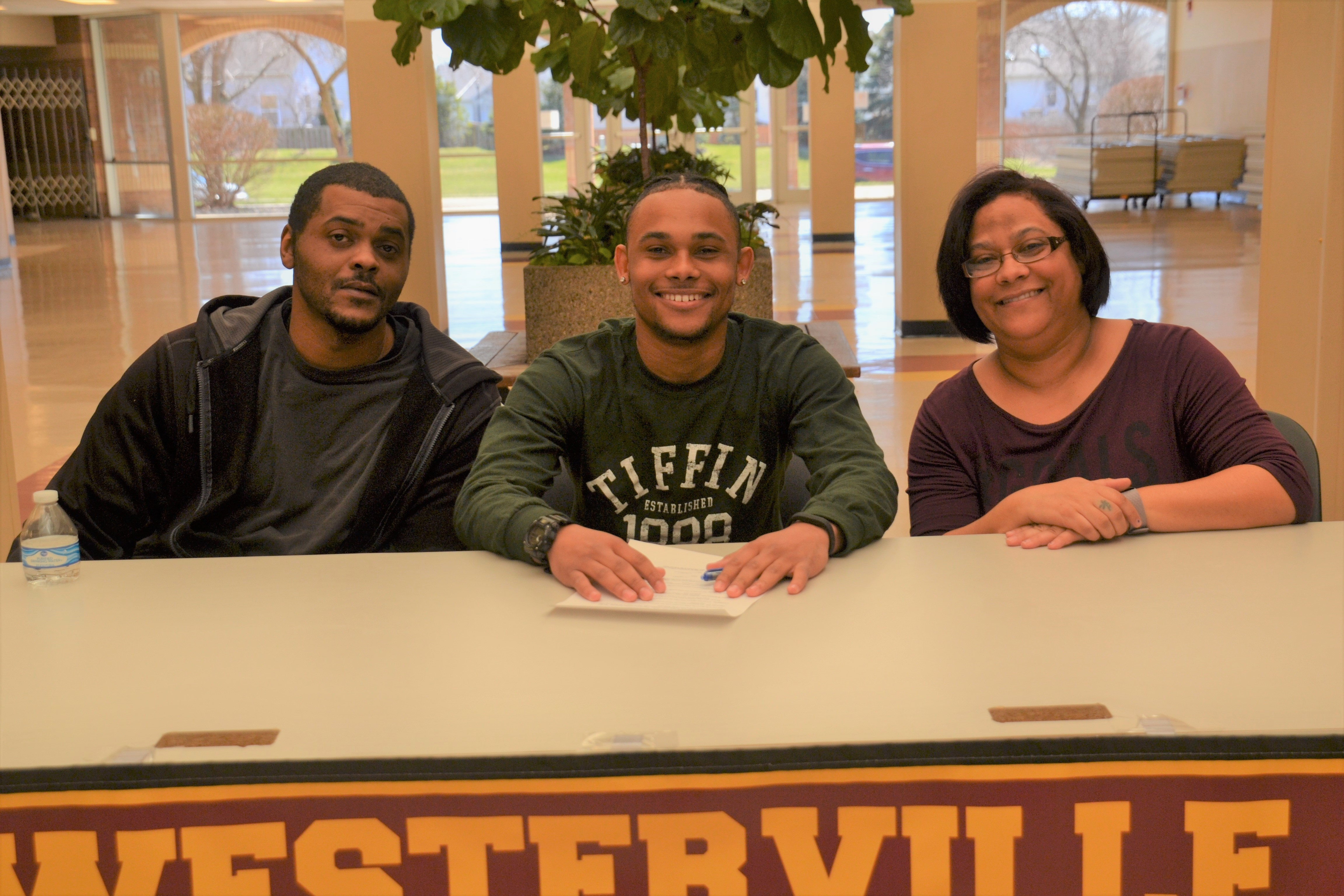 Brandon Mitchell is pictured with his parents, Freedom and Rodrick Mitchell.