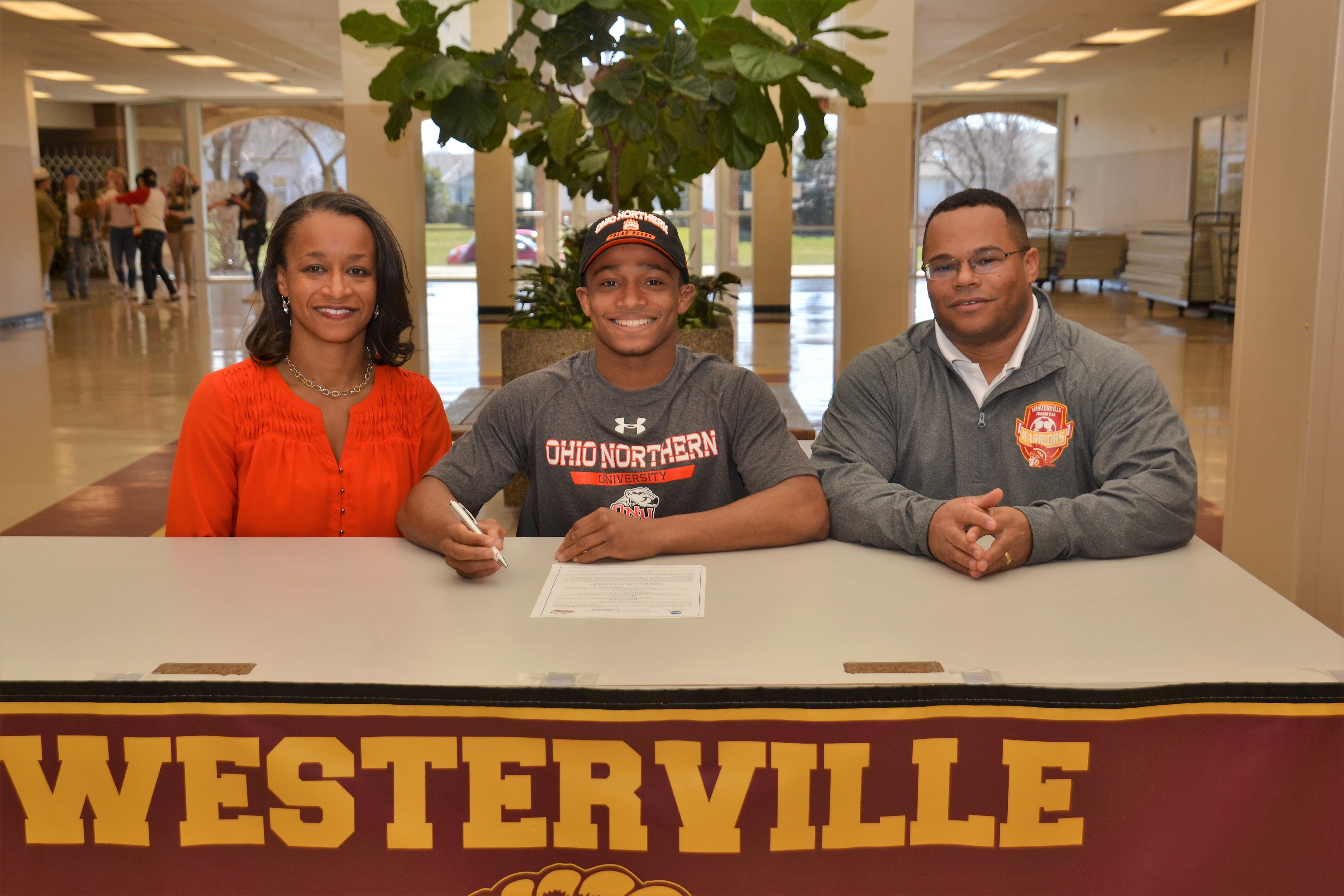 Josh Grant sitting with his parents