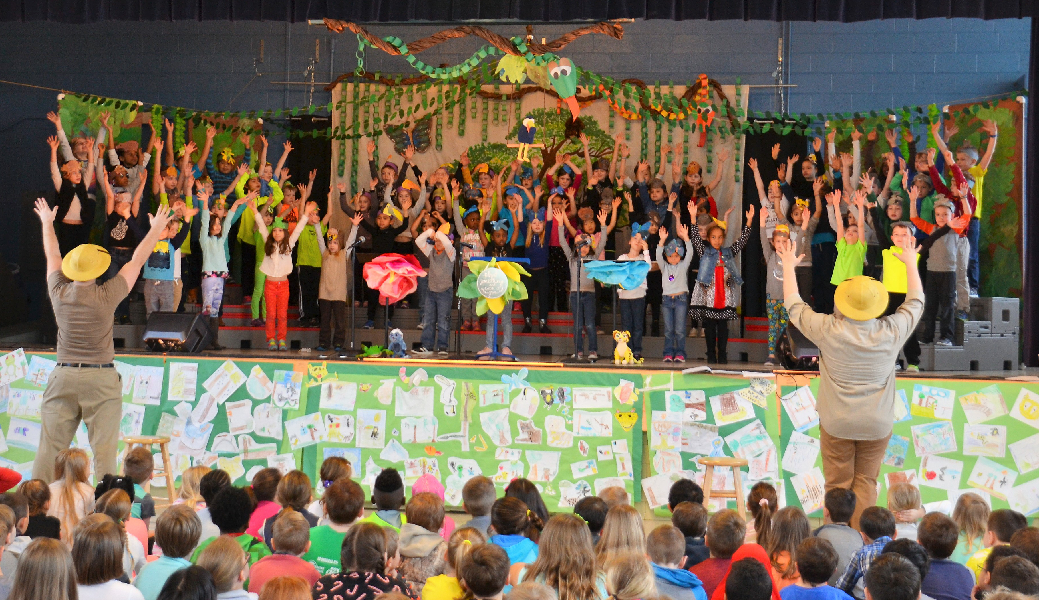 Students on stage performing Singin' in the Rainforest