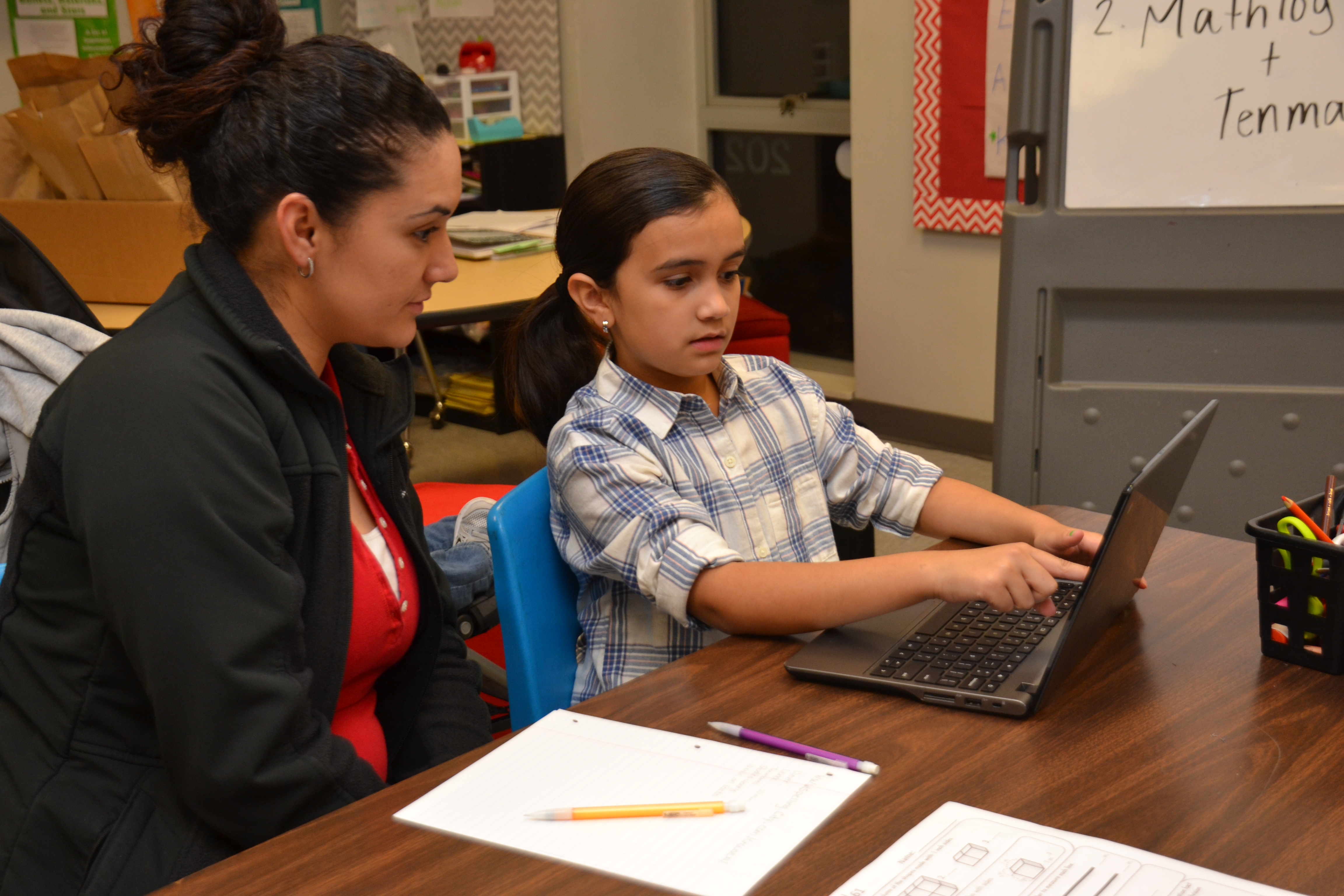 A fourth grade student practices with her mother.