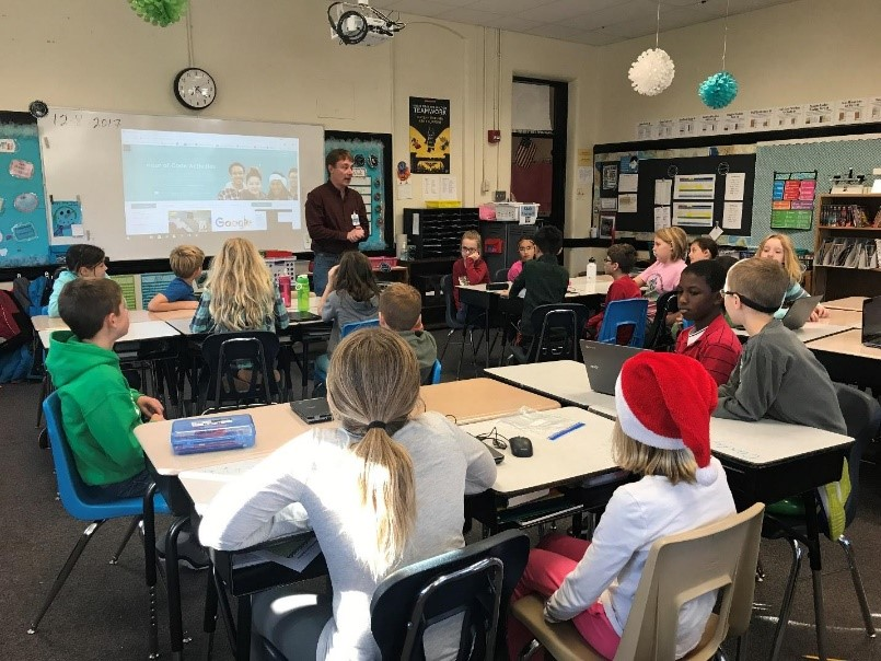 Jeff Richards talks with a class of fourth graders.
