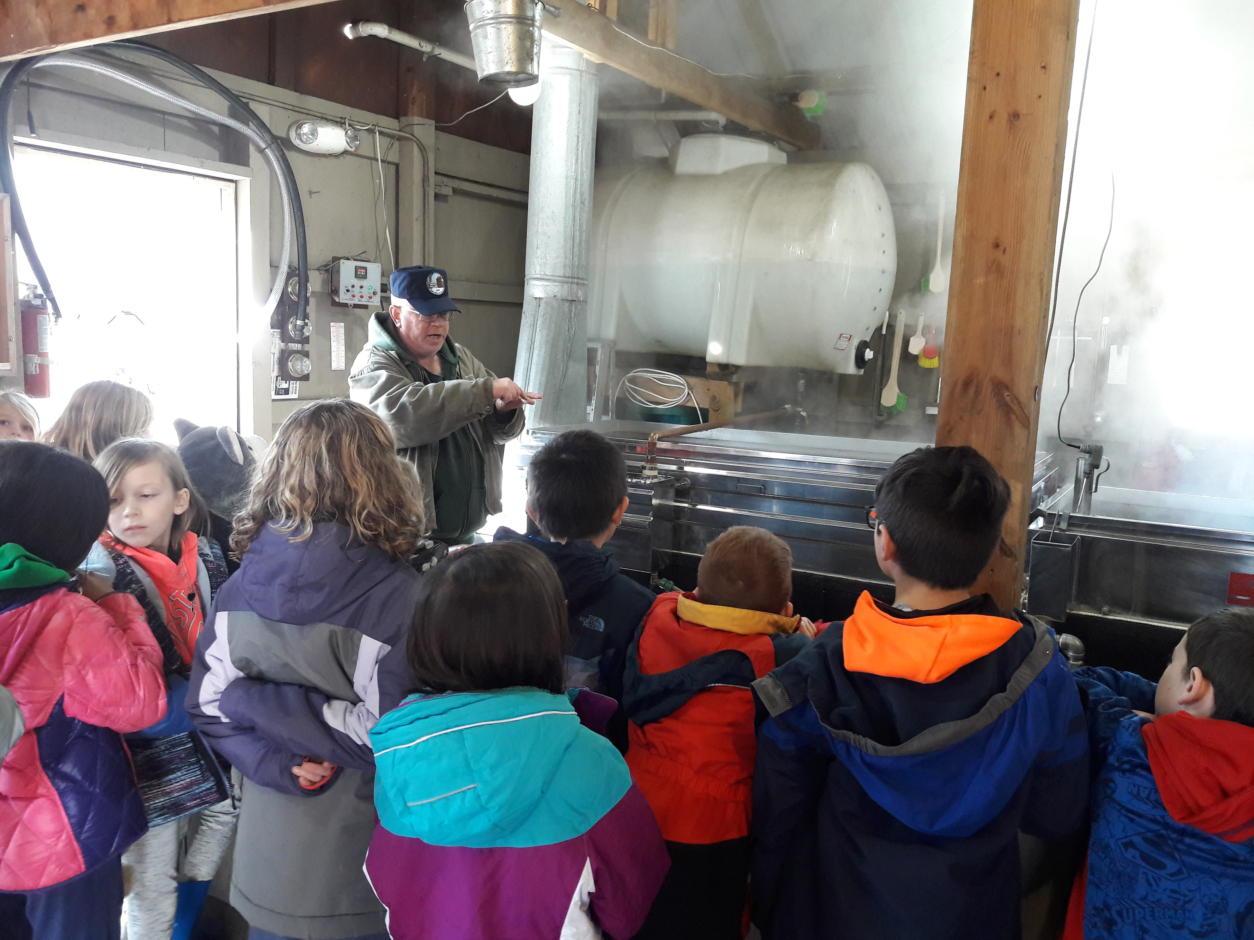 Emerson youngsters watching how maple syrup is made