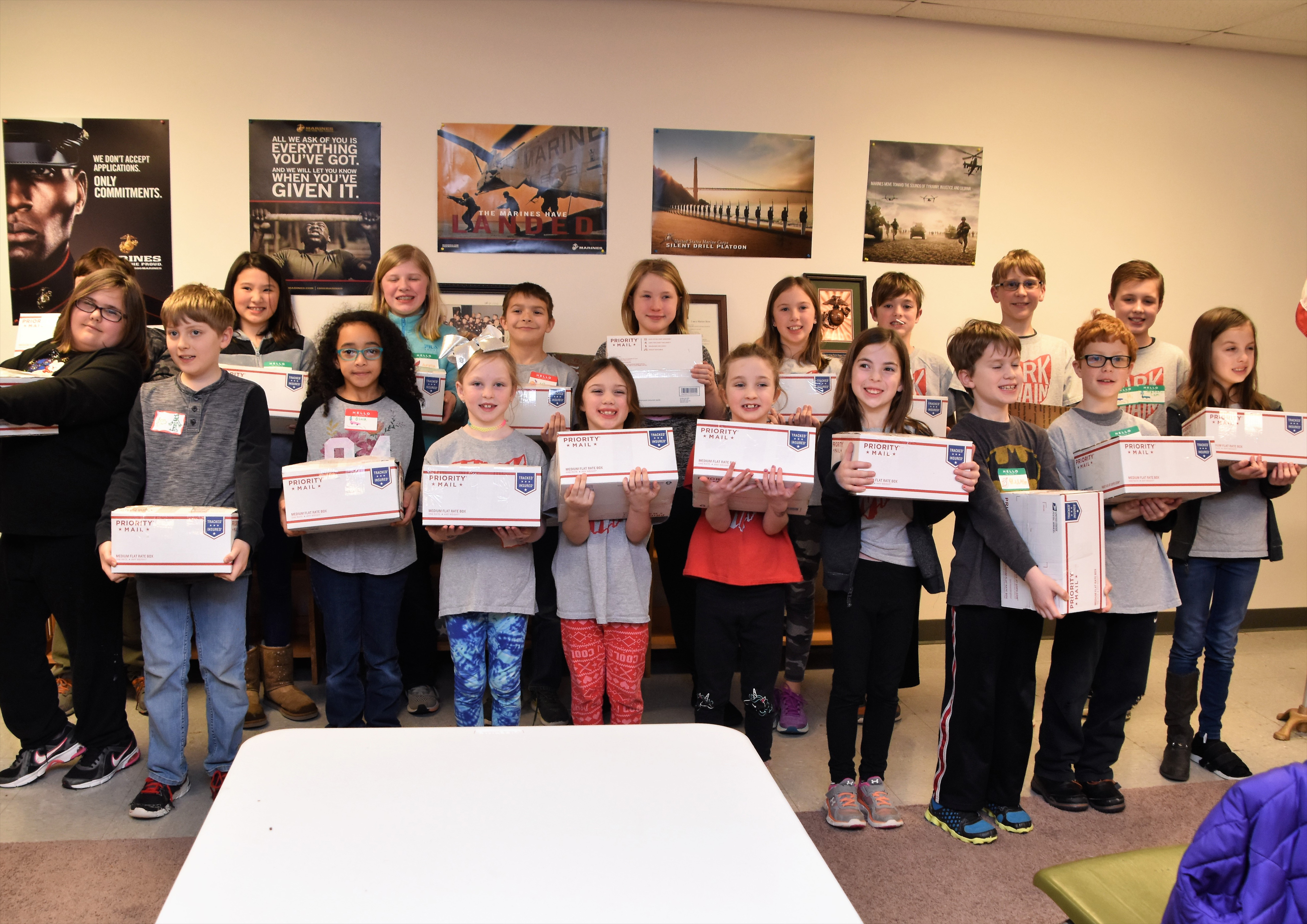 Service Club members holding packed boxes.