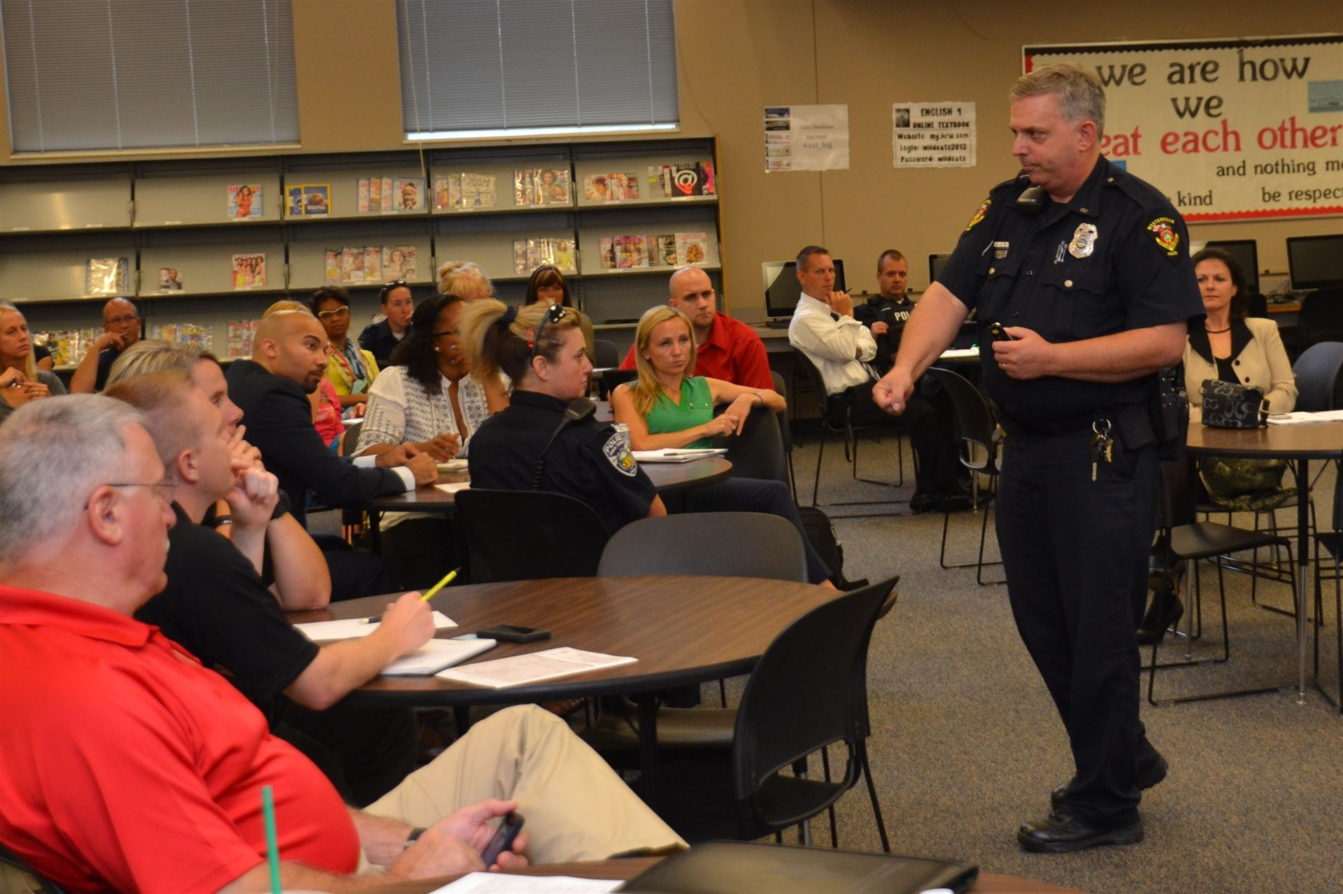"Westerville police officer Thomas ""Cory"" Baker talks with educators"