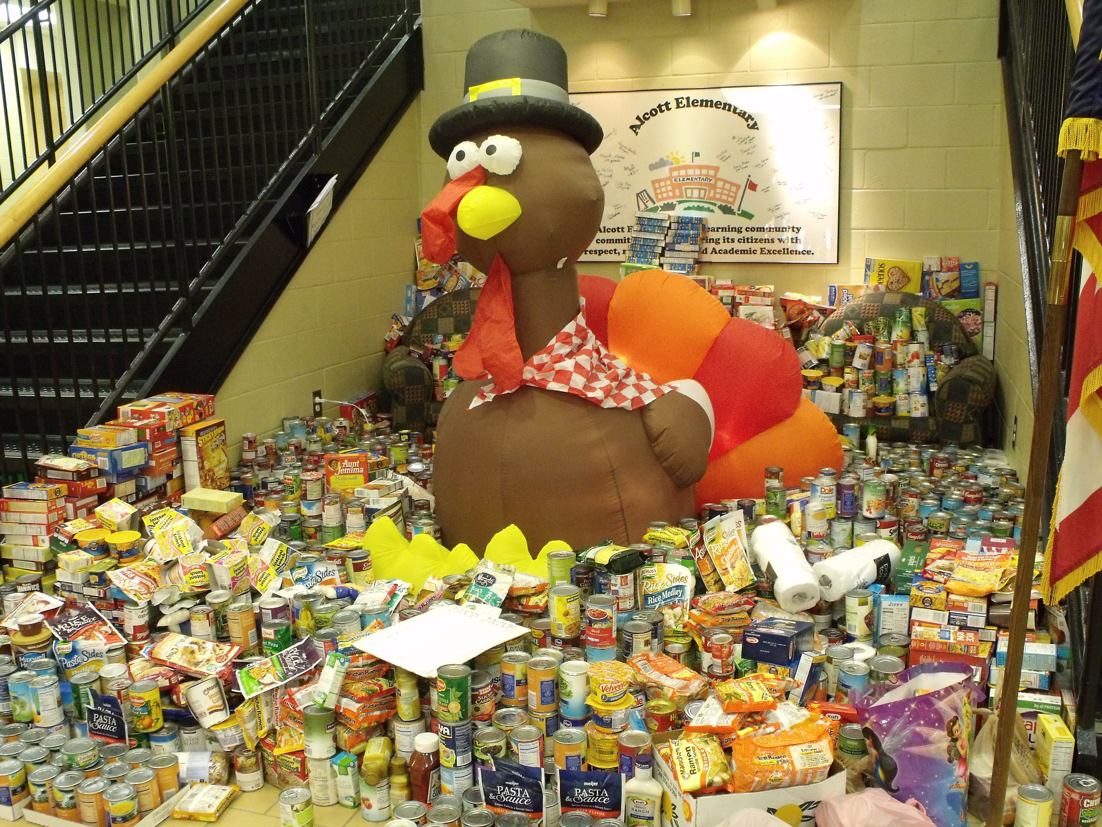Alcott's food and product placed in front of a turkey mascot