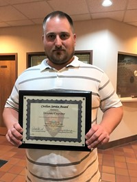 Dominic Carpenter displays his Civilian Service Award from the Westerville Division of Police.