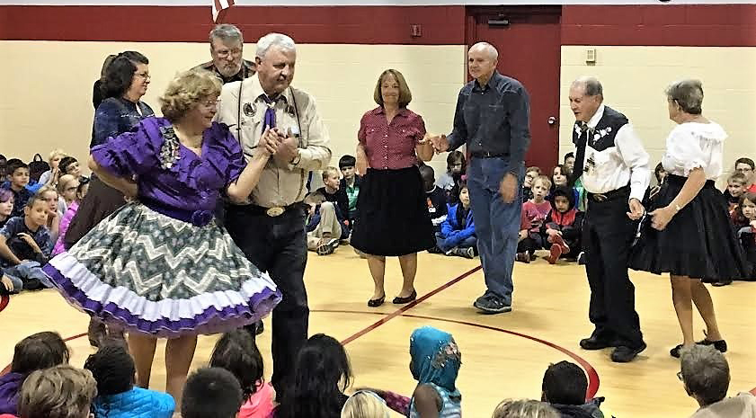 Square dancers perform for students