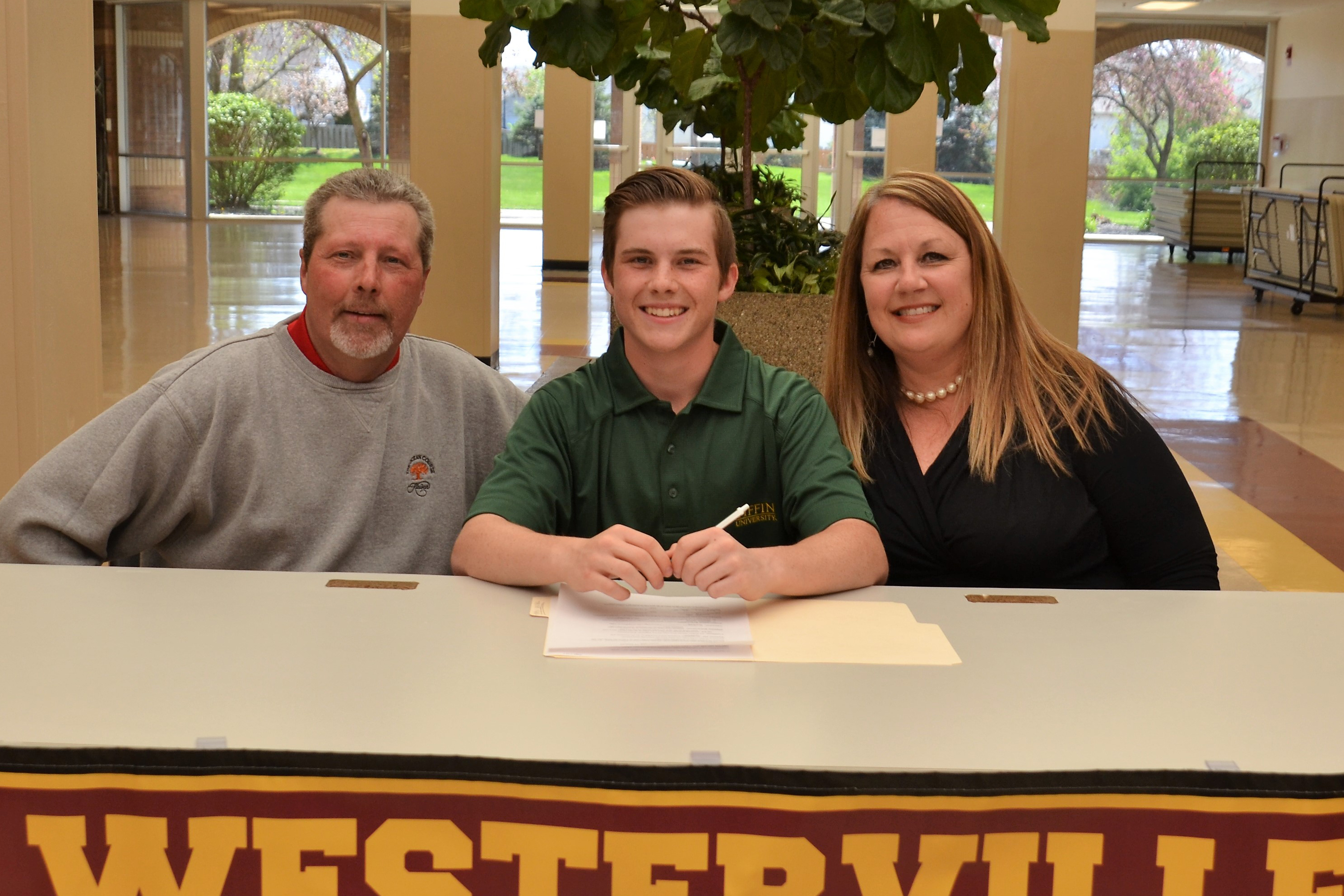 Quinn Gray pictured with his parents