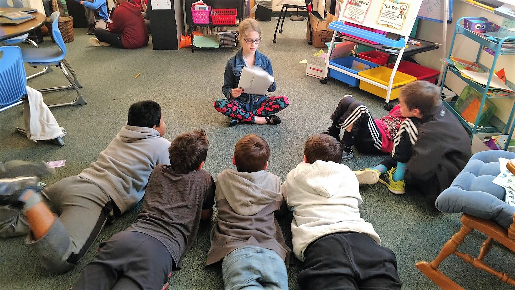 Walnut Springs student reads to a third grade class