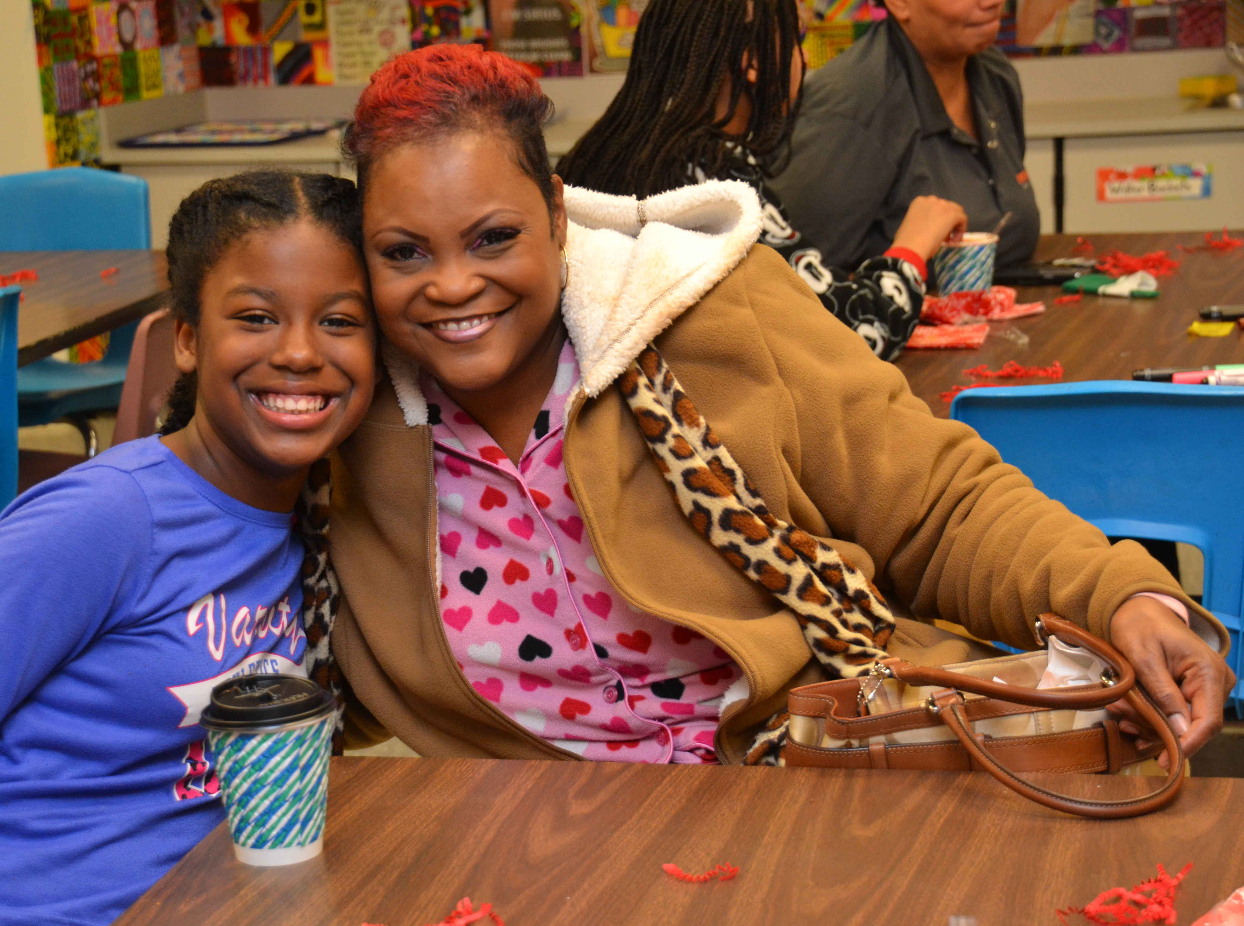 Wilder student enjoys hot chocolate with a family friend