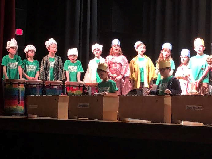 Third grade pupils perform