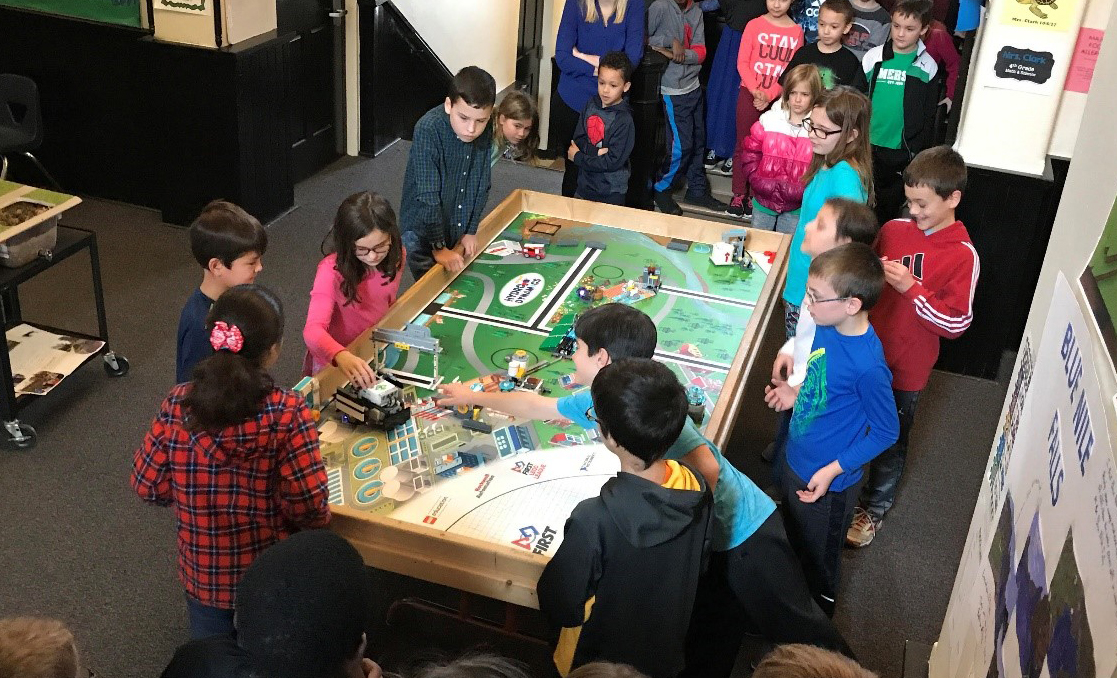Emerson Challengers shows their project to classmates