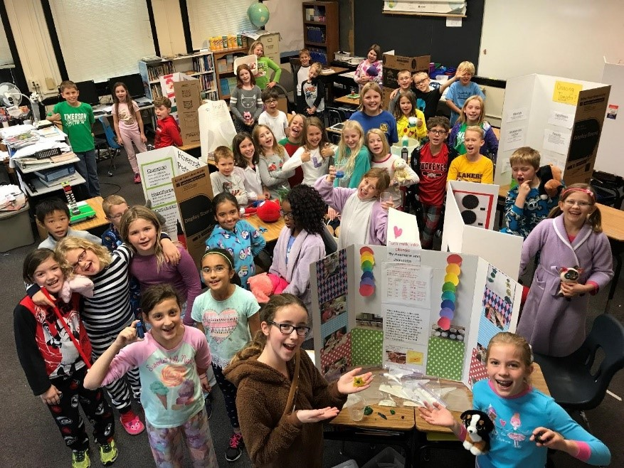 Emerson fourth graders with their displays