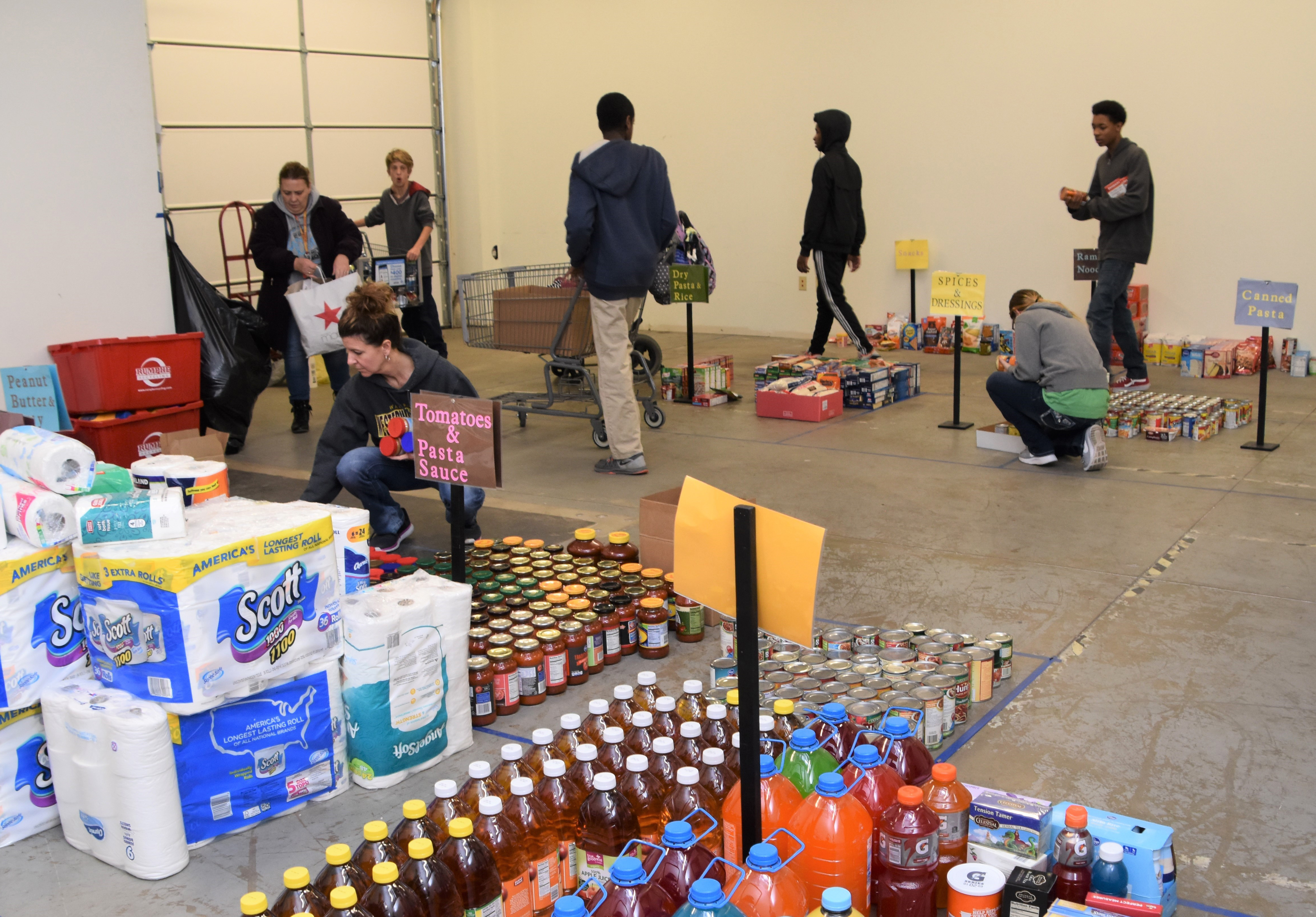 Westerville North students sorting food and paper products for this year's holiday distribution