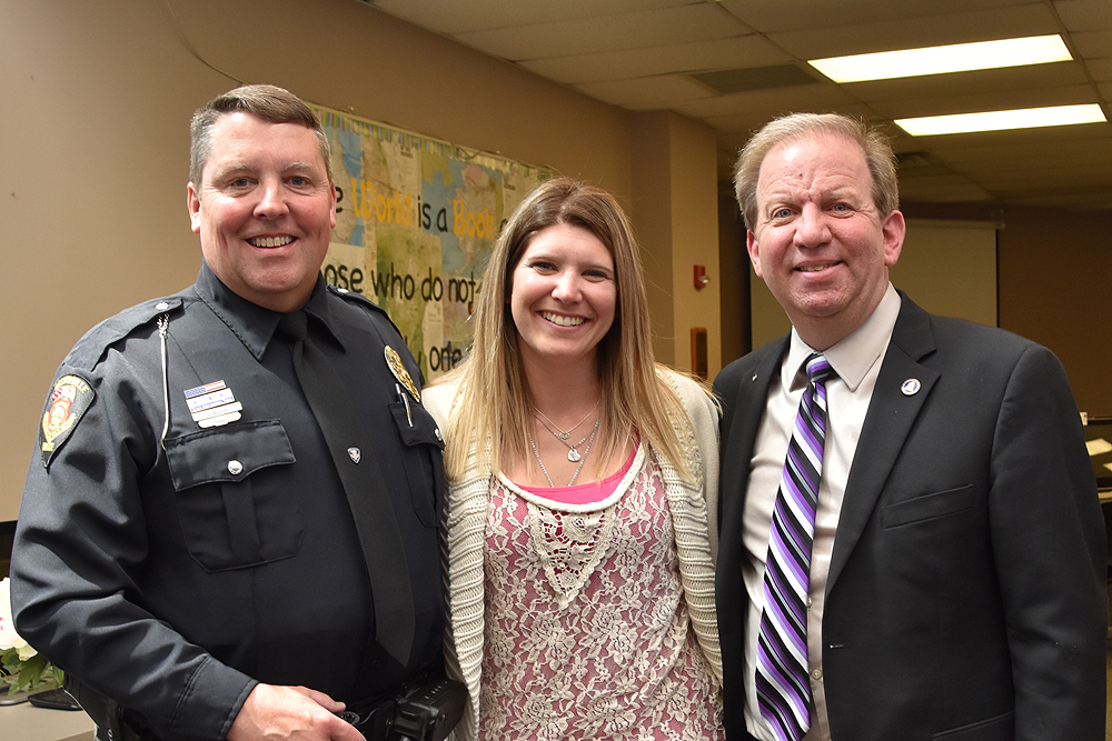 Officer Gary Allen, Mrs. Eric Joering, and Ron Smith