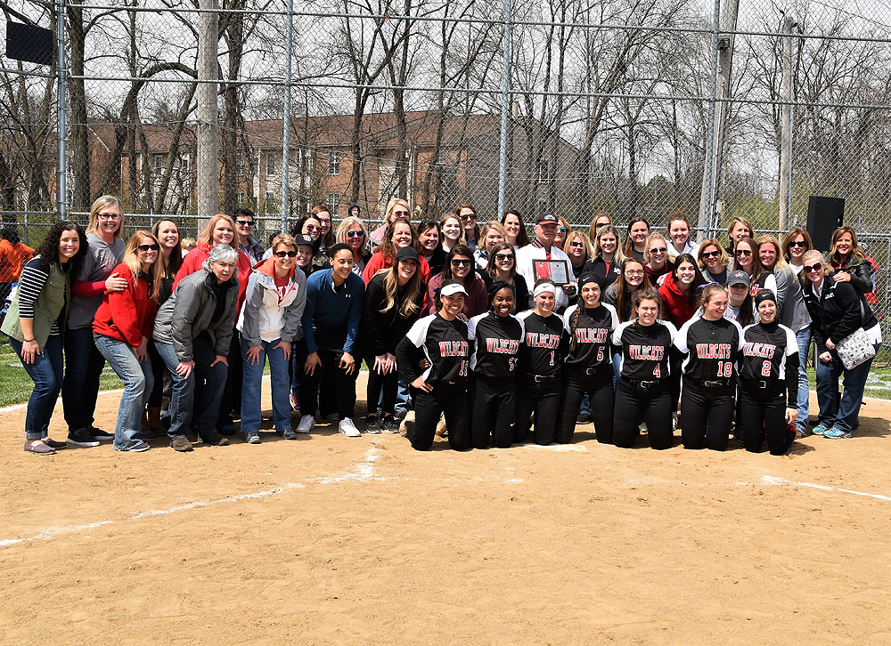Group of former and current softball players, along with Coach Jerry Kelbley