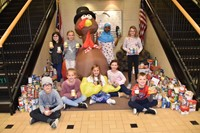 Student Council members with Alcott food drive items