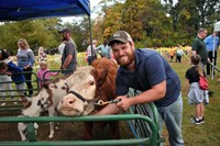 Cody Bush from Horse-N-Round with one of his cows