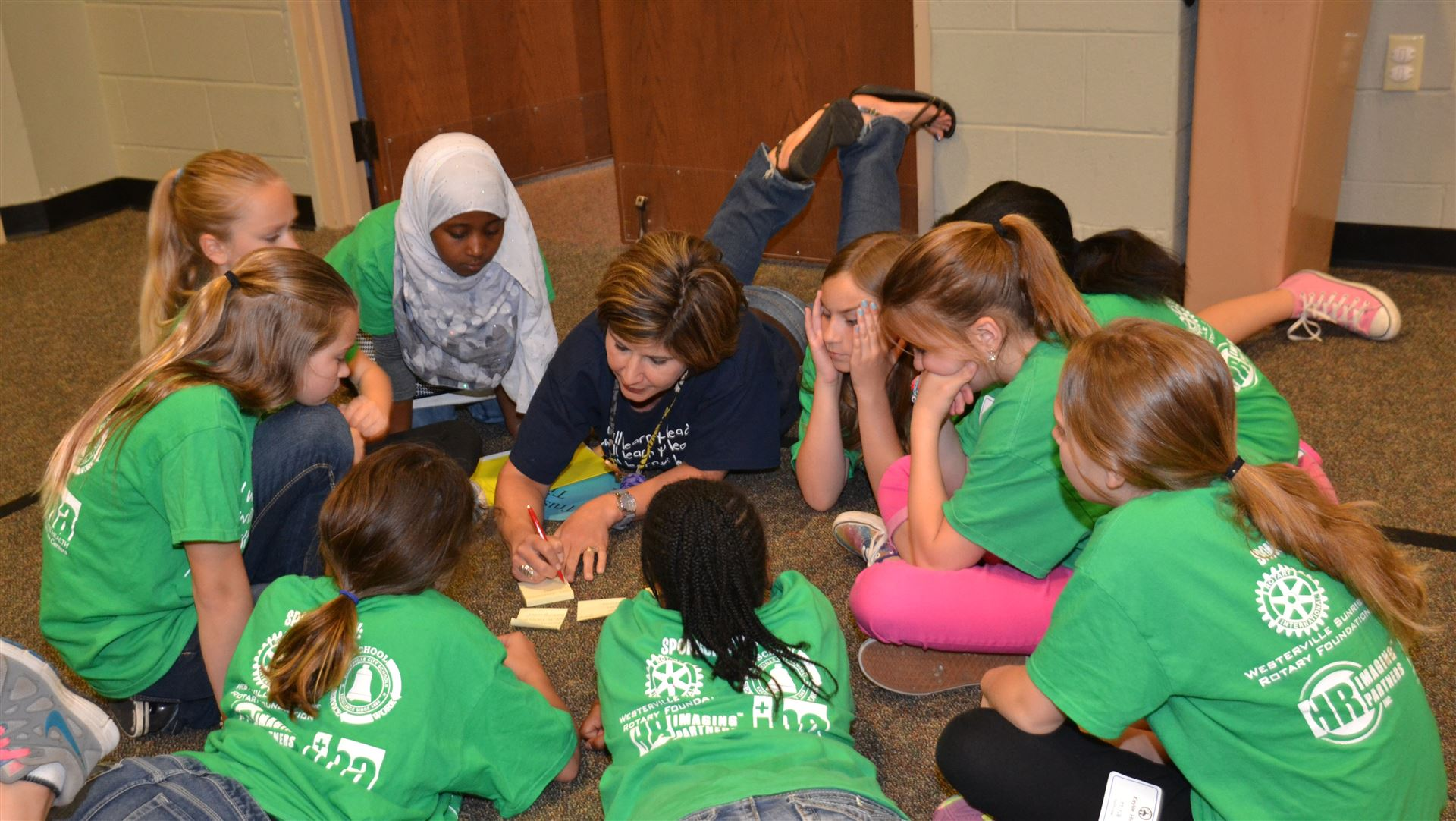 Instructional Coach Kristan Robertson works with a group of students