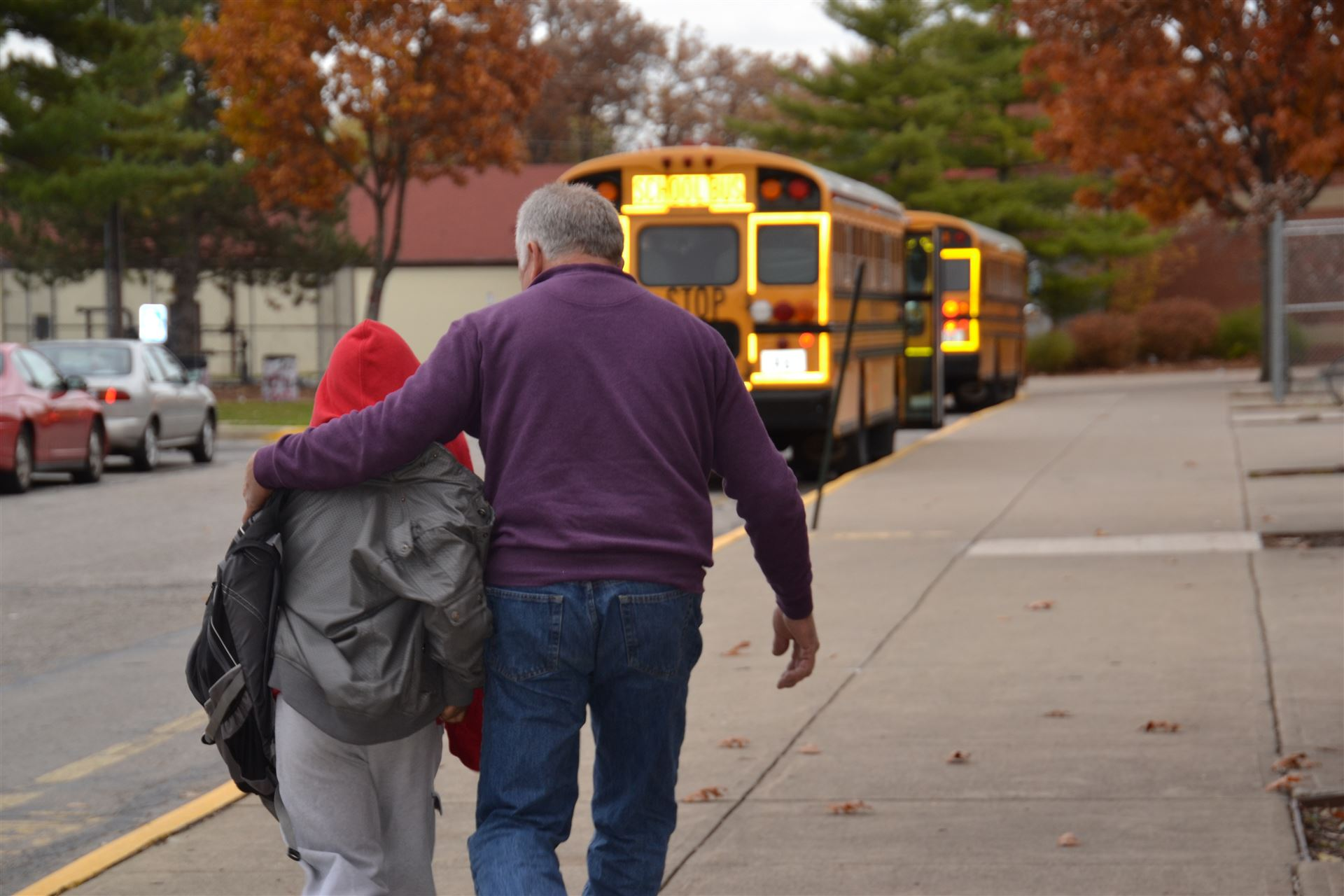 A Westerville City Schools bus driver helps a special needs student transfer to a different bus.