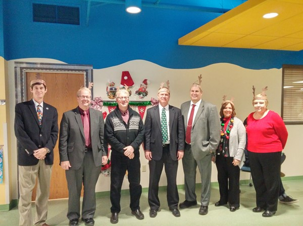 The District Executive Team sang to preschool students during the holiday season.