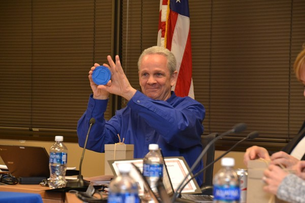 Board President Rick Vilardo displayed a student-made coaster he received during School Board Appreciation Month.