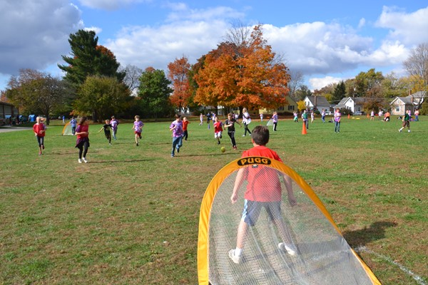 Whittier students play soccer during Field Day.