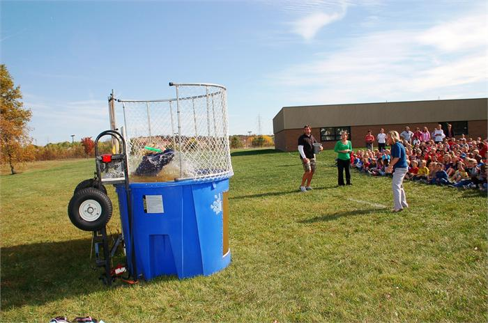 Robert Frost Principal Sarah Berka promised her pupils that she would sit in a dunk tank if they raised $10,000 during the school walk-a-thon.