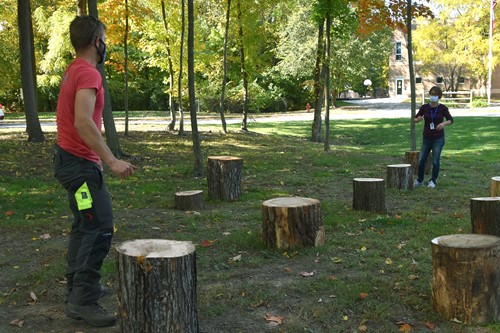Russell Tree Experts donate tree stumps for outdoor classroom at Wilder.