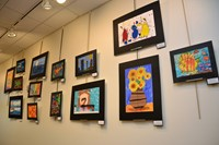 Artwork hanging on display.