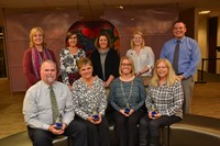 Nine Westerville City Schools employees pose after receiving their A+ Awards