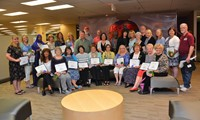 Twenty-nine Retirees posing after the Board of Education reception.