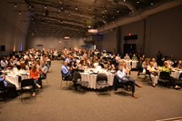 Students, teachers, and energy leaders pack a banquet room at COSI for the Youth Energy Celebration.