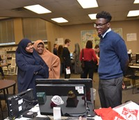 An IB Diploma Candidate discusses his Creativity-Activity-Service experiences with a Westerville South graduate and current student.