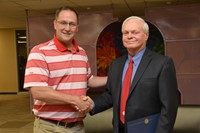 Westerville South High School Principal Mike Starner congratulates Jerry Kelbley
