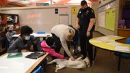 Chloe, a therapy dog-in-training for the Westerville Division of Police, greets students at Annehurst Elementary